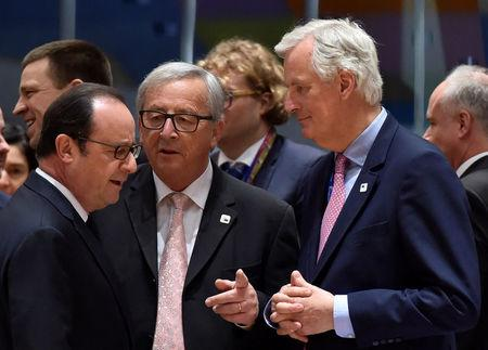 EU Chief Negotiator for Brexit Barnier chats with EC President Juncker and France's President Hollande during a EU summit in Brussels