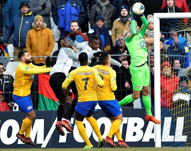 No joy for JS Saint-Pierroise of Reunion Island as Epinal goalkeeper Jerome Idir keeps them at bay in the French Cup (AFP Photo/JEAN-CHRISTOPHE VERHAEGEN)