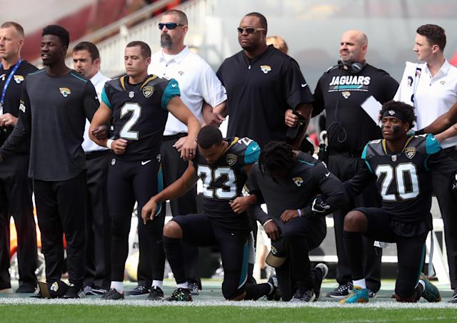 <p>Jacksonville Jaguars players kneel in protest during the national anthem before the NFL International Series match at Wembley Stadium, London on Sept. 24, 2017. (Photo: Simon Cooper/PA Images via Getty Images) </p>