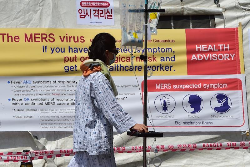 A man walks in front of a quarantine tent for suspected MERS cases at the Seoul National University Hospital in Seoul on June 2, 2015 (AFP Photo/Jung Yeon-Je)