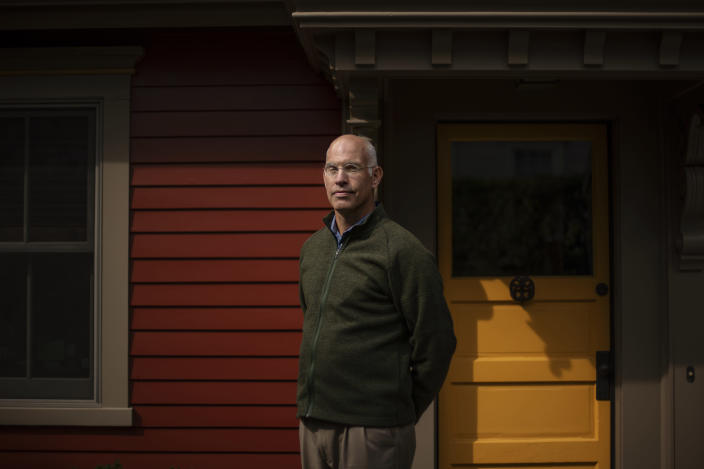 """Seth Handy, 53, a direct descendant of a Pilgrim who came over on the Mayflower, stands for a portrait outside his home in Providence, R.I., Tuesday, Sept. 22, 2020. For Handy, it's a difficult issue to reconcile. """"The pilgrims came out of religious persecution in England. And I'm very proud of the fact that they set off to create their own independent culture,"""" said Handy. """"But they came to a place where there was existing culture. And, you know, the history is not friendly and that is troublesome,"""" he said. Handy added that it's more important now than ever now to """"recognize everyone's role in our history and the great diversity of this country."""" (AP Photo/David Goldman)"""