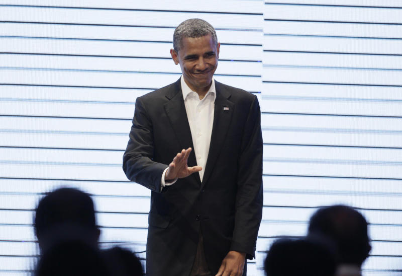 President Barack Obama waves to the audience upon his arrival to the CEO Summit of the Americas, in Cartagena, Colombia, Saturday April 14, 2012. Regional business leaders are meeting parallel to the sixth Summit of the Americas which brings together presidents and prime ministers from Canada, the Caribbean, Latin America and the U.S. (AP Photo/Carolyn Kaster)