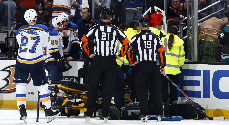 The St. Louis Blues watch as paramedics tend to teammate Jay Bouwmeester after he collapsed on the bench during an NHL regular season game in February. (Photo by Debora Robinson/NHLI via Getty Images)