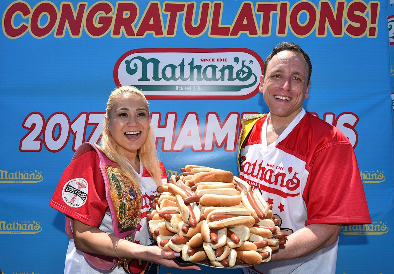 <p>Winners of the Nathan's Famous Fourth of July International Hot-dog eating contest, Miki Sudo with 41 hotdogs and Joey Chestnut with 72 in Coney Island, New York on July 4, 2017. ( Erik Pendzich/REX/Shutterstock ) </p>