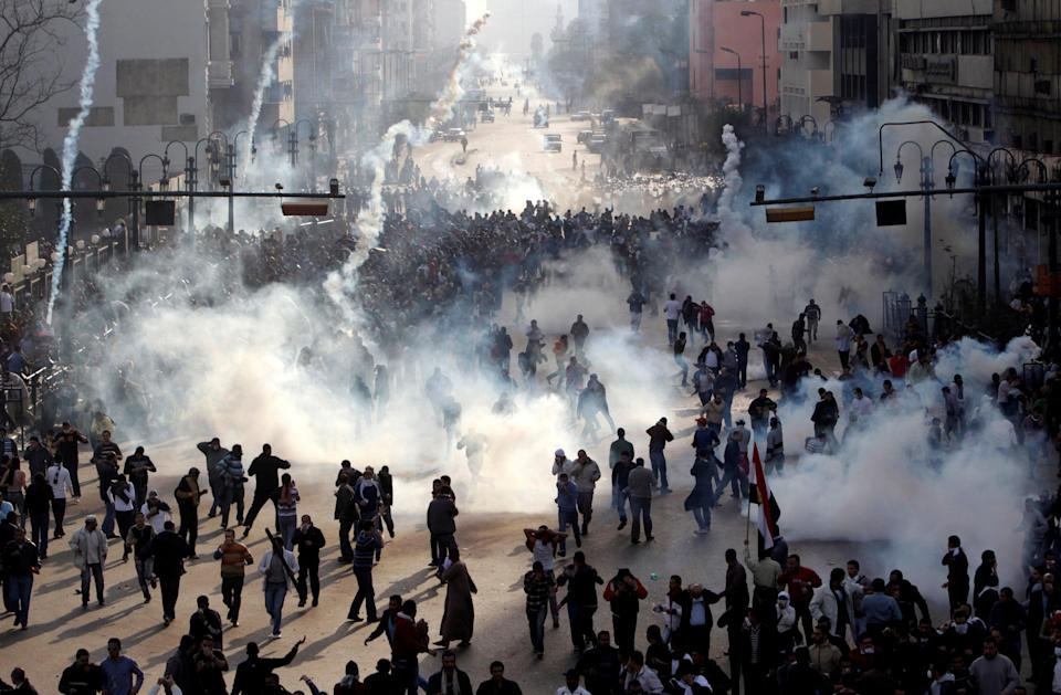 Protesters flee from tear gas fire during clashes in CairoReuters