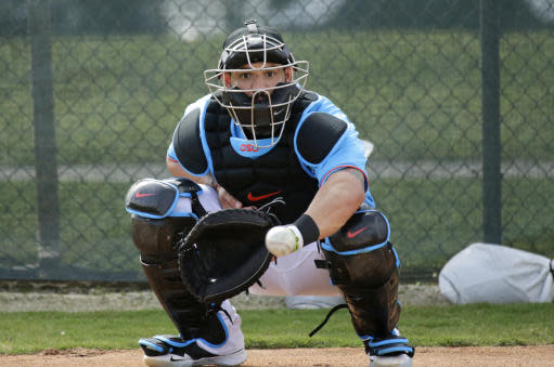 FILE - In this Feb. 12, 2020, file photo, Miami Marlins catcher Jorge Alfaro eyes the baseball during a spring training baseball workouts for pitchers and catchers at Roger Dean Stadium in Jupiter, Fla. Francisco Cervelli says hes fully recovered from his latest concussion, and Jorge Alfaro says hes feeling fitter after an offseason spent working on the farm and running sprints. At catcher, at least, the Miami Marlins appear in good shape. (David Santiago/Miami Herald via AP, File)
