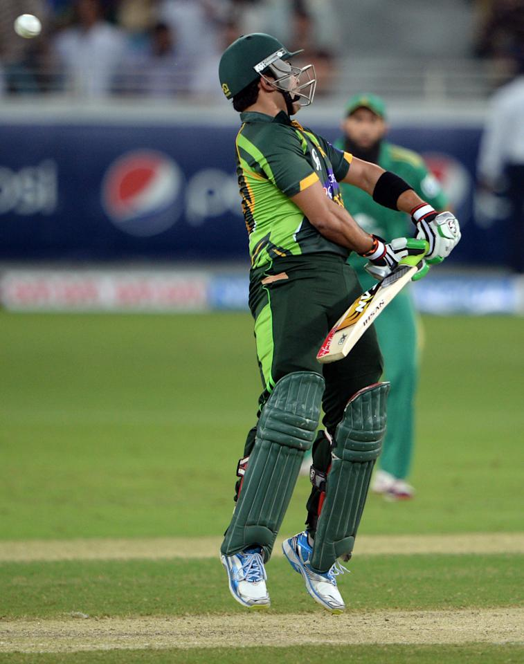 Pakistani batsman Kamran Akmal avoids a ball during the First T20 International at Dubai stadium on November 13, 2013. Pakistan captain Mohammad Hafeez won the toss and elected to bat in the first Twenty20 international against South Africa in Dubai . AFP PHOTO/ Asif HASSAN        (Photo credit should read ASIF HASSAN/AFP/Getty Images)
