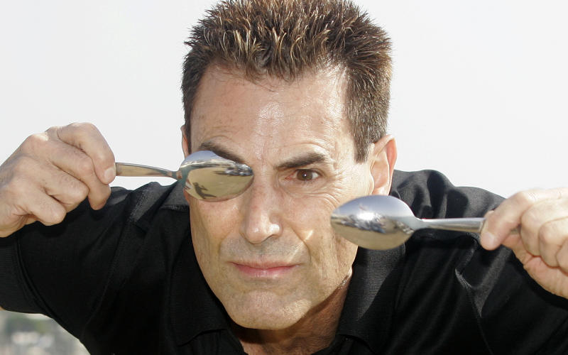 Israeli-British illusionist Uri Geller poses during the 24th MIPCOM (International Film and Programme Market for Tv, Video,Cable and Satellitte) in Cannes, southeastern France, Tuesday, Oct 14, 2008. (AP Photo/Lionel Cironneau)
