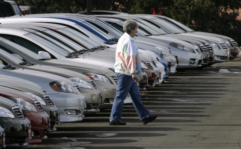 FILE - In this Feb. 18, 2007 file photo, an unidentified buyer searches through long lines of unsold 2007 Corolla and Camry sedans at a Toyota dealership in Boulder, Colo. Toyota Motor Corp. is recalling 7.43 million vehicles in the U.S., Japan, Europe and elsewhere around the world for a faulty power-window switch — the latest, massive quality woes for Japan's top automaker. The recall, announced Wednesday, Oct. 10, 2012 affects more than a dozen models produced from 2005 through 2010. (AP Photo/David Zalubowski, file)