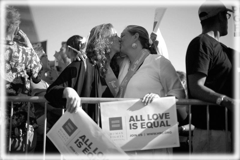 Deirdre Weaver (L), 47, and her wife Nancy Grass, 48, who have been together for 15 years, kiss at a rally in West Hollywood, California after the United States Supreme Court ruled on California's Proposition 8 and the federal Defense of Marriage Act June 26, 2013. (Photo: Lucy Nicholson/Reuters; digitally enhanced by Yahoo News)
