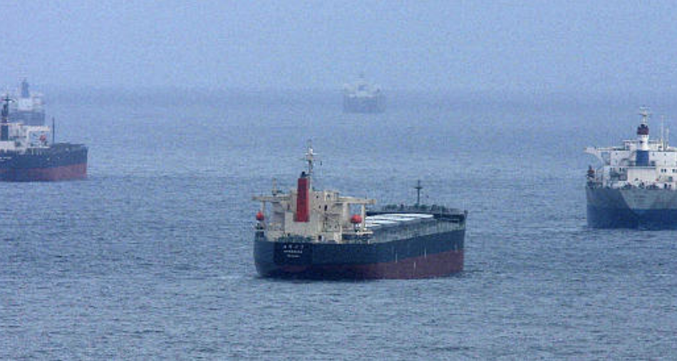 Coal tankers are seen waiting offshore.