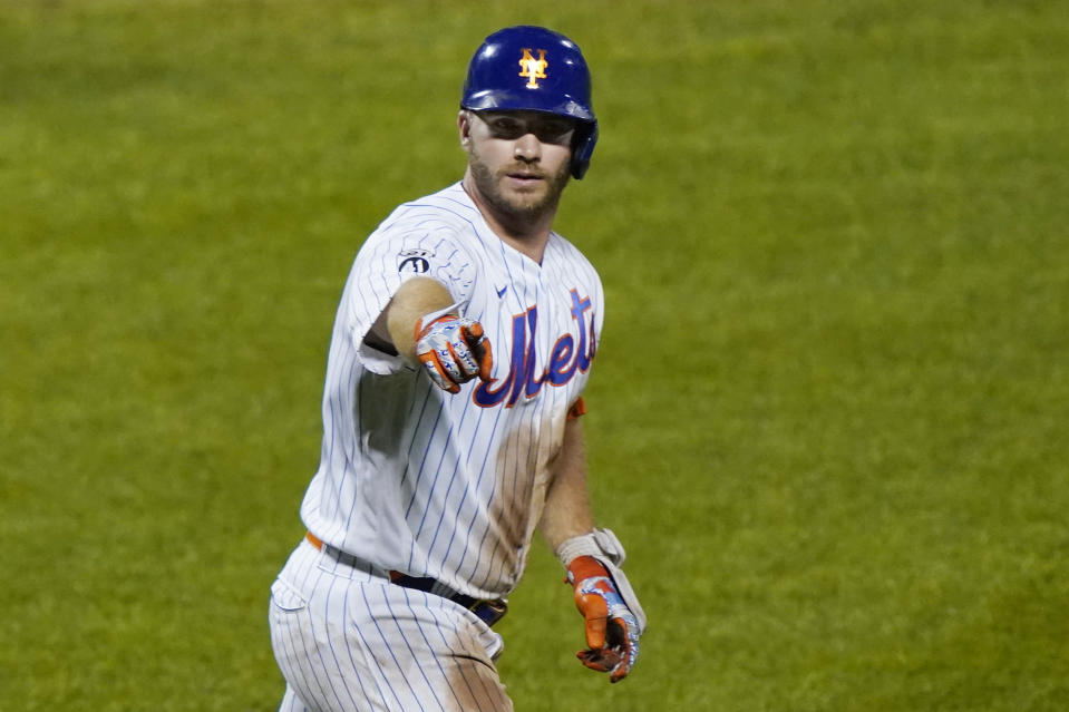 New York Mets designated hitter Pete Alonso (20) points to the dugout after hitting a solo home run during the eighth inning of the team's baseball game against the Baltimore Orioles, Wednesday, Sept. 9, 2020, in New York. (AP Photo/Kathy Willens)