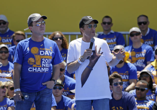 Warriors owners Joe Lacob (left) and Peter Guber pledged to foot the bill for the team's championship parade in June. (AP)