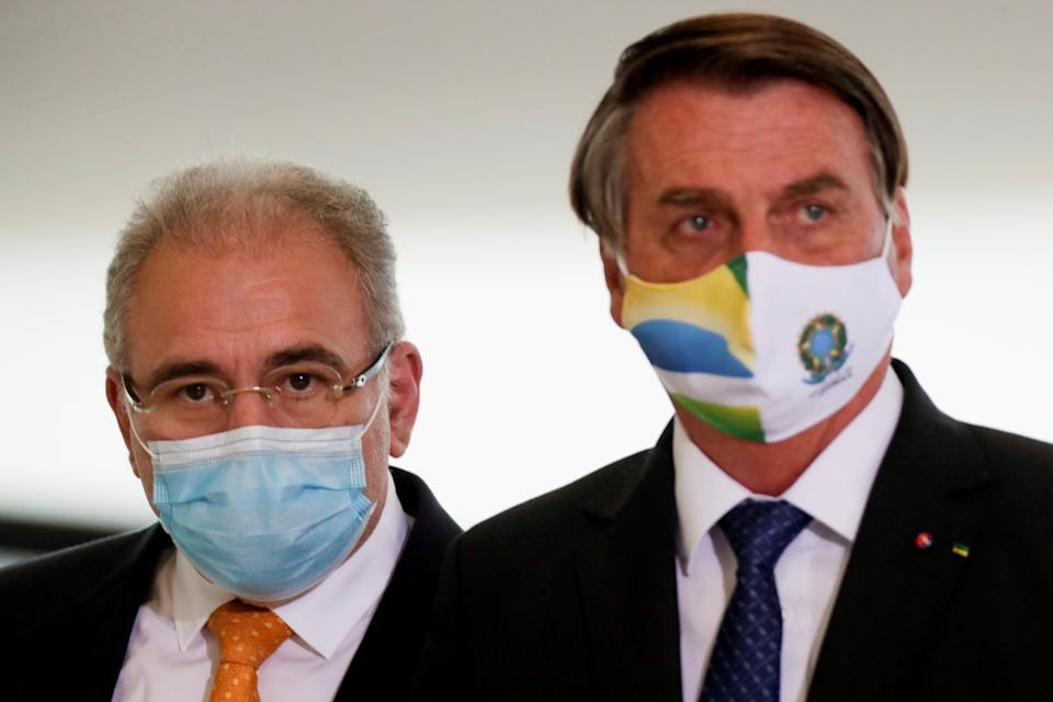 Brazil's Health Minister Marcelo Queiroga and Brazil's President Jair Bolsonaro arrive for a ceremony of release of resources for Primary Health Care in combat of the coronavirus disease (COVID-19), at the Planalto Palace in Brasilia, Brazil May 11, 2021. REUTERS/Ueslei Marcelino