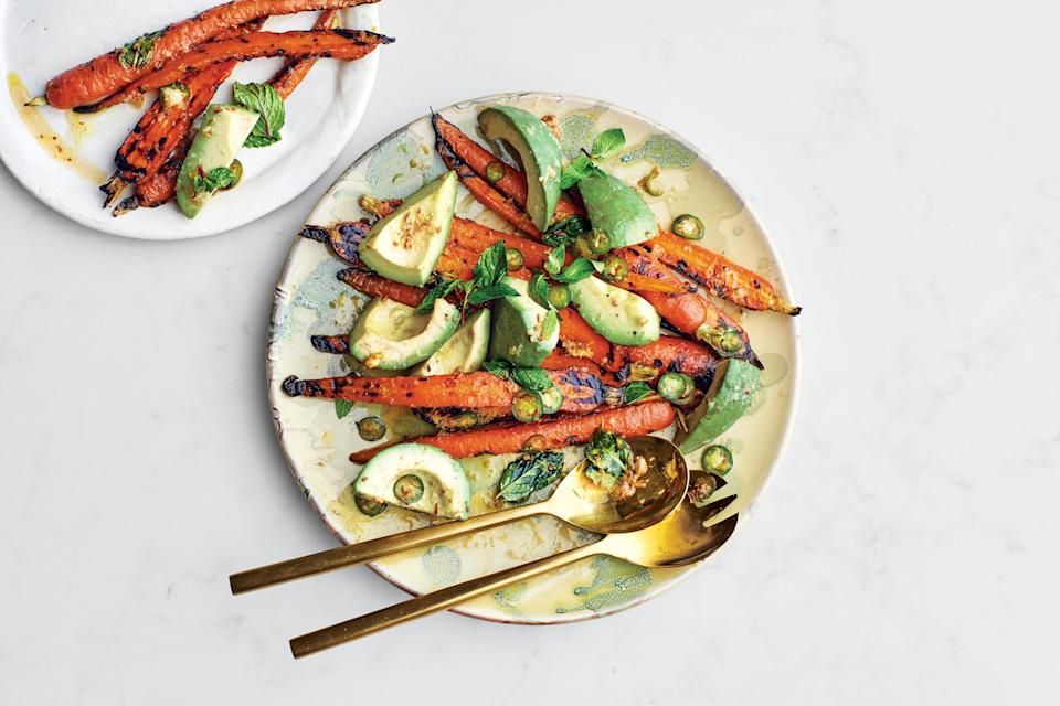 """Toss grilled carrots and fresh avocados with a chile-ginger dressing that's sweetened with honey for a simple side that, honestly, could double as a light lunch on all its own. <a href=""""https://www.epicurious.com/recipes/food/views/grilled-carrots-with-avocado-and-mint?mbid=synd_yahoo_rss"""" rel=""""nofollow noopener"""" target=""""_blank"""" data-ylk=""""slk:See recipe."""" class=""""link rapid-noclick-resp"""">See recipe.</a>"""