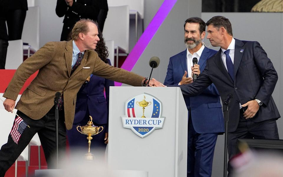 Team USA captain Steve Stricker and Team Europe captain Padraig Harrington shake hands during the opening ceremony for the Ryder Cup at the Whistling Straits Golf Course Thursday, Sept. 23, 2021, in Sheboygan, Wis - AP