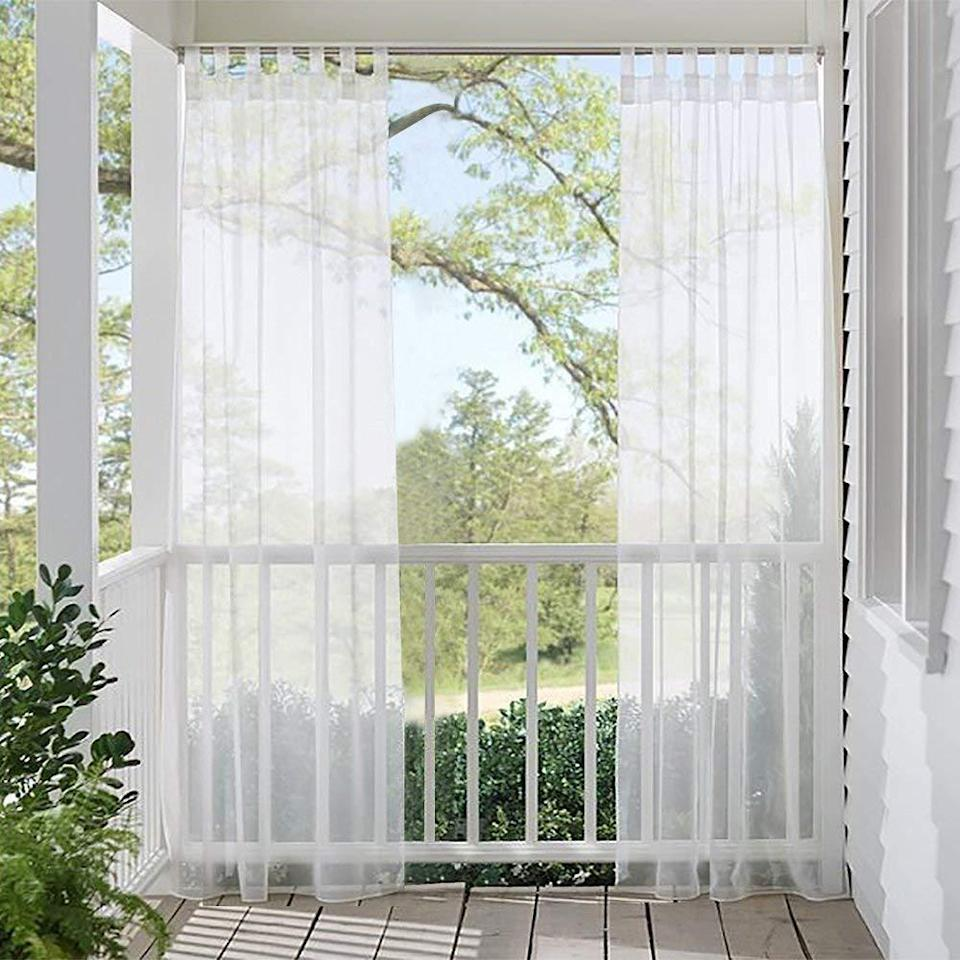 "<p>If you need to block the sun but don't want to use an umbrella, try sheer curtains along the edges of your deck, like these from the curtain brand <a href=""https://snowcityshop.com/products/linen-look-semi-sheer-white-outdoor-curtains-patio-panels-tab-loop-top-privacy-sheer-curtains-light-filter-volie-for-porch?utm_medium=cpc&utm_source=google&utm_campaign=Google%20Shopping&gclid=CjwKCAjwi_b3BRAGEiwAemPNUwjJhvSeat9tnPtuLS-THtYkaXdTgyAjGGqjPqX2Kt_YVO2AHpkvmhoCV24QAvD_BwE&variant=30938071793710"" rel=""nofollow noopener"" target=""_blank"" data-ylk=""slk:Snowcity"" class=""link rapid-noclick-resp"">Snowcity</a>. They still allow some light in but don't make the space feel more confined.</p>"