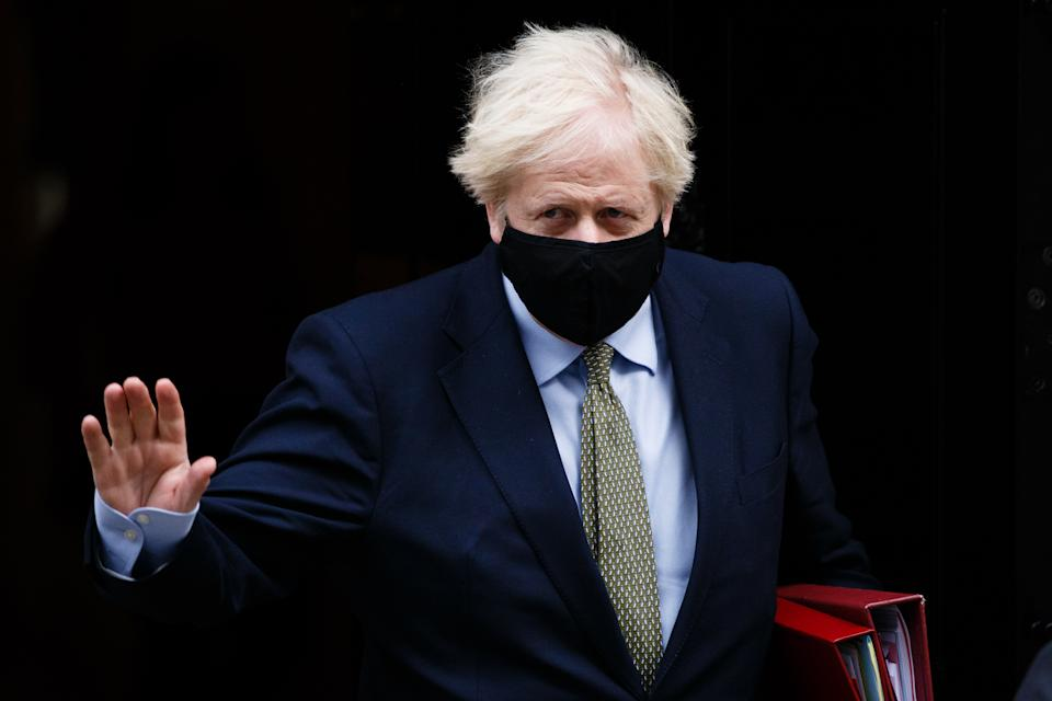 British Prime Minister Boris Johnson leaves 10 Downing Street wearing a face mask on his way to Prime Minister's Questions (PMQs) at the House of Commons in London, England, on October 14, 2020. (Photo by David Cliff/NurPhoto via Getty Images)