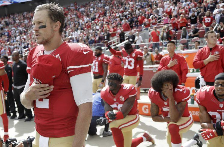 Blaine Gabbert (2) was signed before 2016 49ers teammate Colin Kaepernick (background, kneeling). (AP)