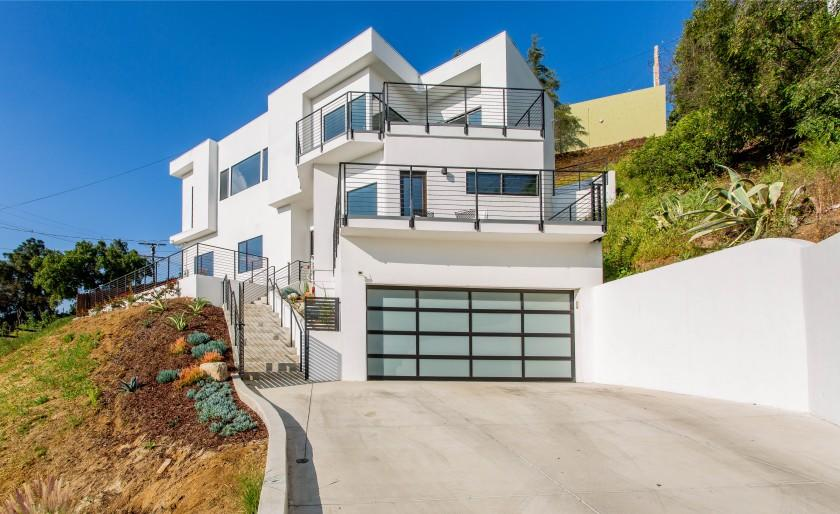 Built in 2014, the two-story stucco home takes advantage of the scenic view with picture windows and a pair of decks.