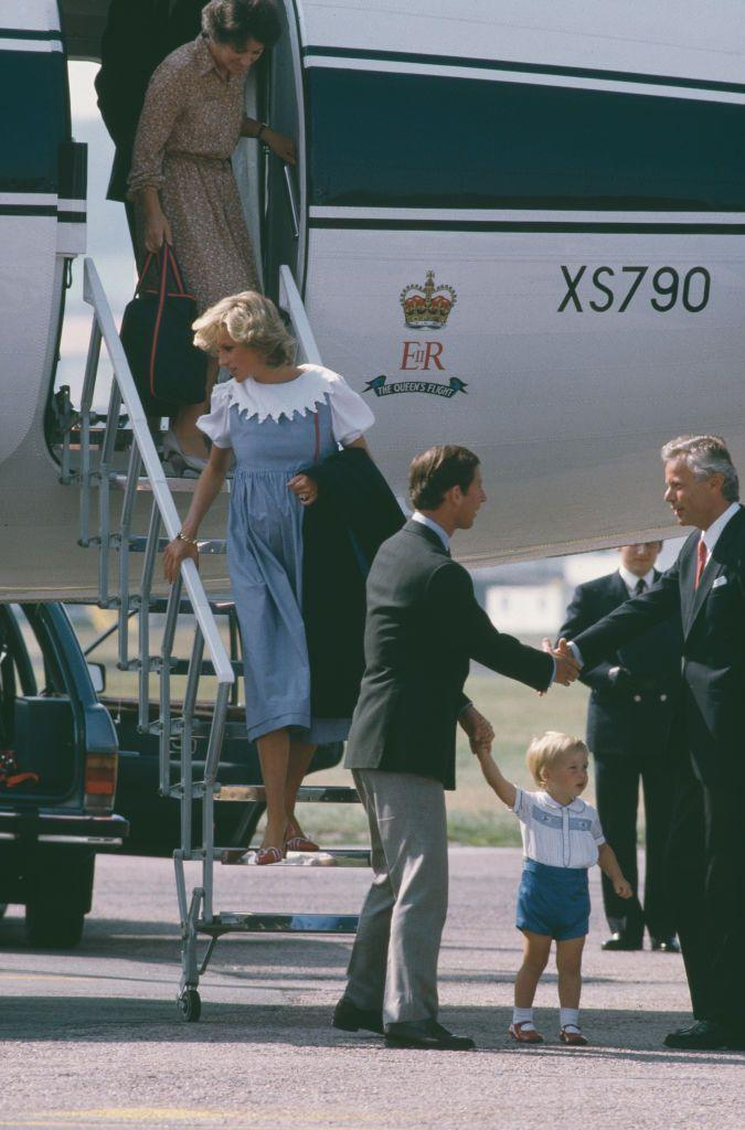 <p>Diana arrives at Aberdeen airport in Scotland on The Queen's Flight with Prince Charles and their son Prince William in August 1984 while Diana was pregnant with Prince Harry.</p>