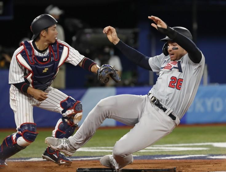 TOKYO, - AUGUST 02: Triston Casas from Team USA slides into home plate.