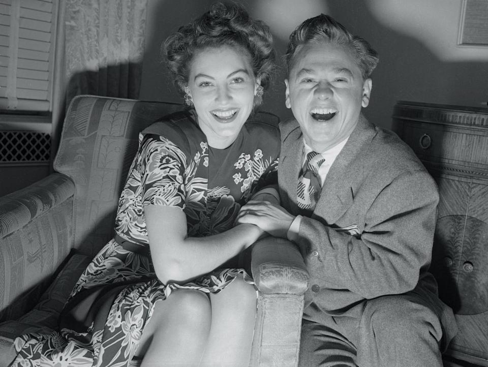 <p>Gardner and then-husband Rooney (they were married in 1942 in Santa Barbara) pose during a holiday visit to New York City. The North Carolina–born actress looks decidedly stylish in a floral patterned dress and youthful updo. </p>