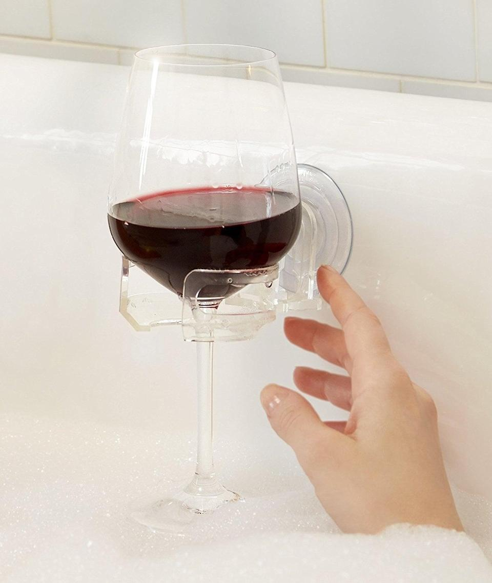 <p>This <span>SipCaddy Bath &amp; Shower Portable Cupholder Caddy</span> ($14) lets you take wine in the bath. Enough said.</p>