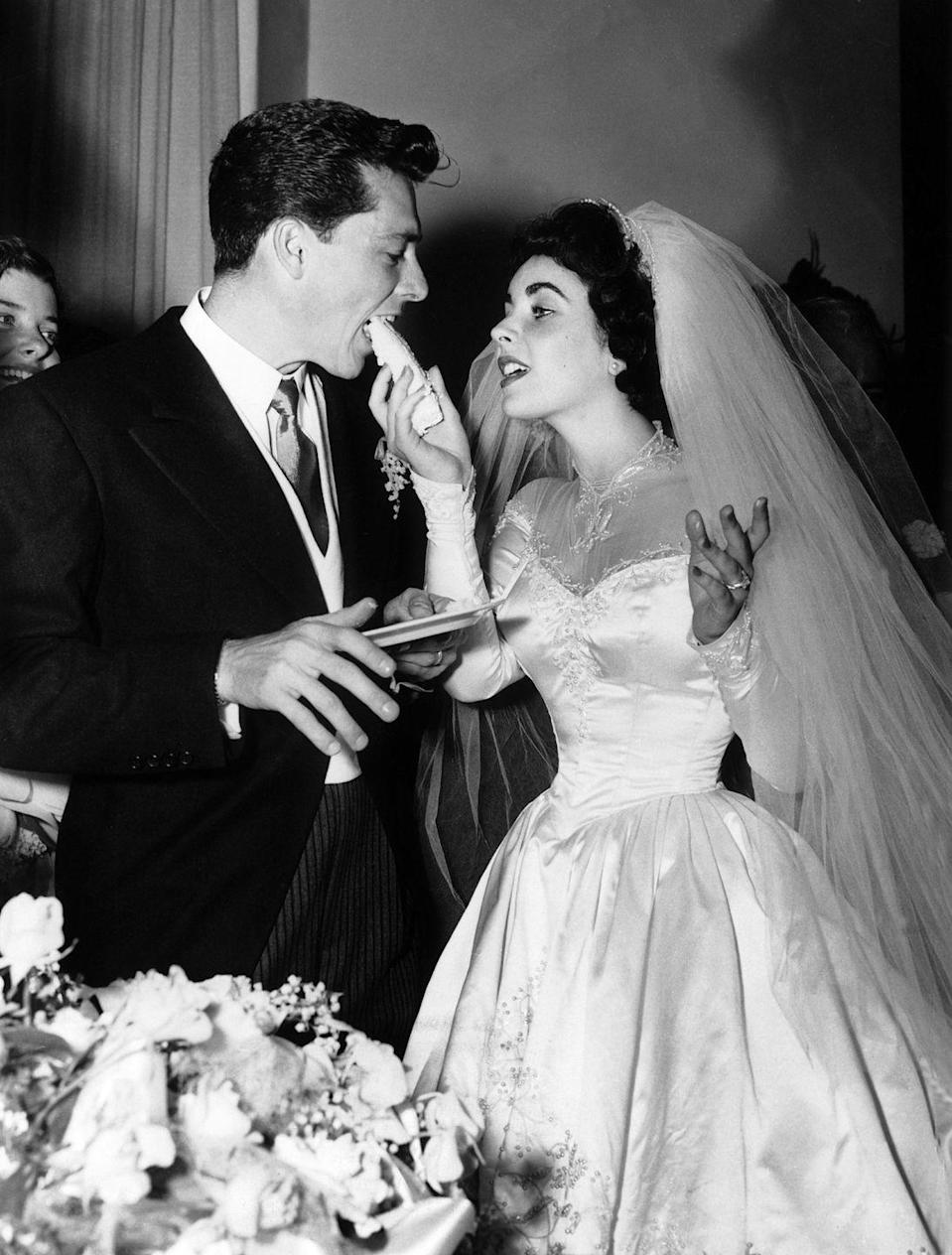 "<p>Eighteen-year-old Elizabeth Taylor wed the first of her seven spouses, Conrad ""Nicky"" Hilton, 23, on May 6, 1950. Their Bel-Air Country Club reception was Hollywood's social event of the year. Liz wore a gown by designer Helen Rose, who created both Taylor's wardrobe in <em>Father of the Bride </em>(released in 1950) and Grace Kelly's wedding dress. </p>"