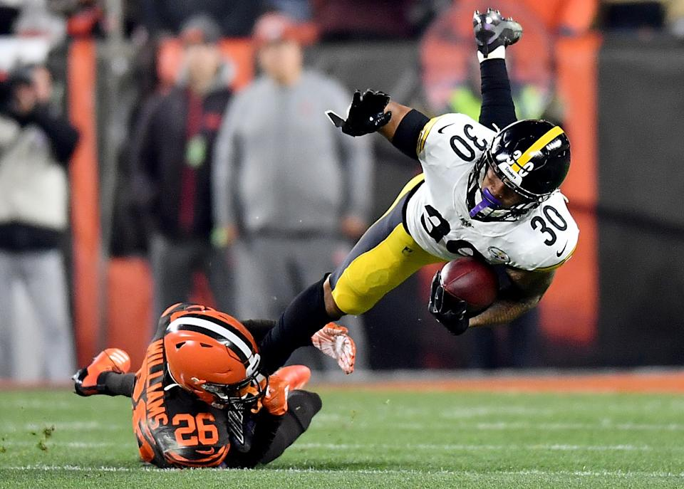CLEVELAND, OHIO - NOVEMBER 14: Running back James Conner #30 of the Pittsburgh Steelers is tackled by cornerback Greedy Williams #26 of the Cleveland Browns  at FirstEnergy Stadium on November 14, 2019 in Cleveland, Ohio. (Photo by Jamie Sabau/Getty Images)