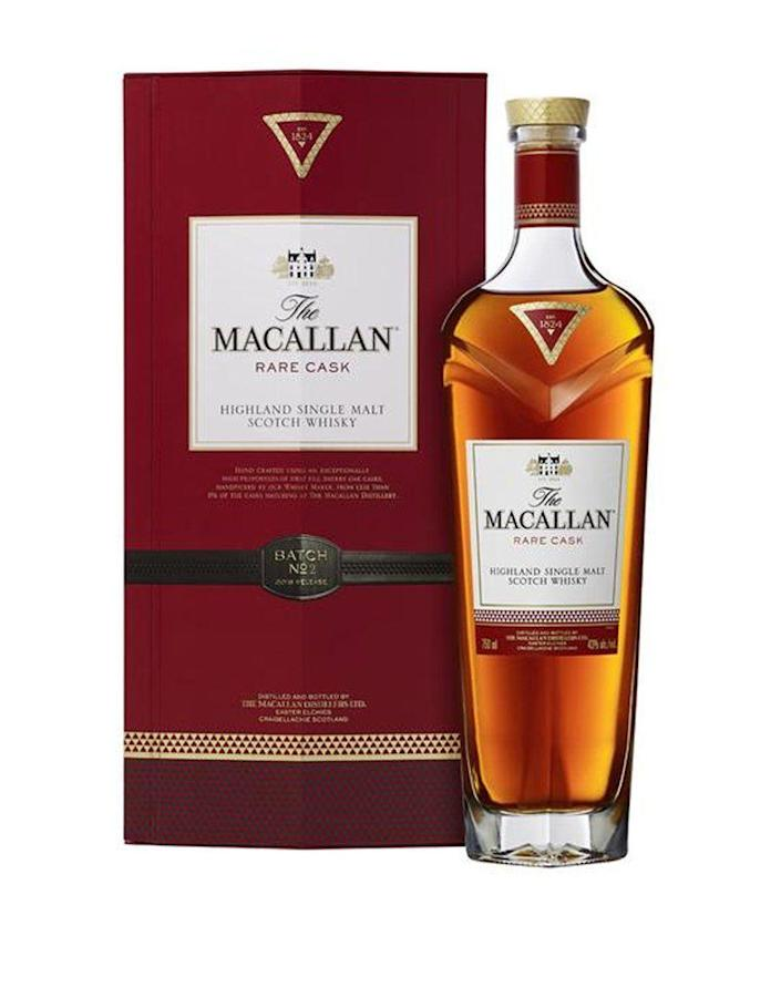 """<p><strong>The Macallan</strong></p><p>reservebar.com</p><p><strong>$375.00</strong></p><p><a href=""""https://go.redirectingat.com?id=74968X1596630&url=https%3A%2F%2Fwww.reservebar.com%2Fproducts%2Fthe-macallan-rare-cask&sref=https%3A%2F%2Fwww.townandcountrymag.com%2Fleisure%2Fdrinks%2Fnews%2Fg1750%2Fholiday-wine-and-spirits-gift-guide%2F"""" rel=""""nofollow noopener"""" target=""""_blank"""" data-ylk=""""slk:Shop Now"""" class=""""link rapid-noclick-resp"""">Shop Now</a></p><p>Want to give something rare this holiday? It doesn't get much more unique that this Scotch, which is aged in first-fill sherry casks that are hand picked by The Macallan's Master Whiskey Maker (the brand says that less than 1% of casks make the cut.) </p>"""