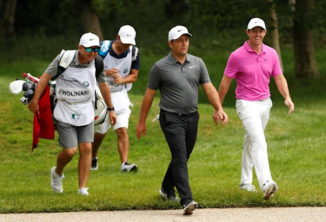 Golf - European Tour - BMW PGA Championship - Wentworth Club, Virginia Water, Britain - May 27, 2018 Italy's Francesco Molinari and Northern Ireland's Rory McIlroy share a joke during the final round Action Images via Reuters/Paul Childs
