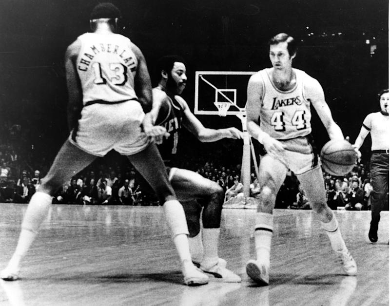 Lakers guard Jerry West drives to his left while Wilt Chamberlain sets a screen.