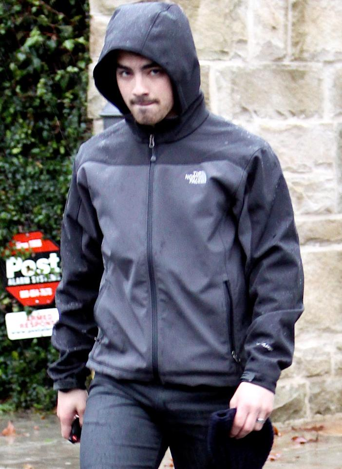 """Disney dream Joe Jonas covered his head to keep the rain off his well-tended tresses while leaving the home of his bro and bandmate, Nick. Fabio/<a href=""""http://www.x17online.com"""" target=""""new"""">X17 Online</a> - January 20, 2010"""