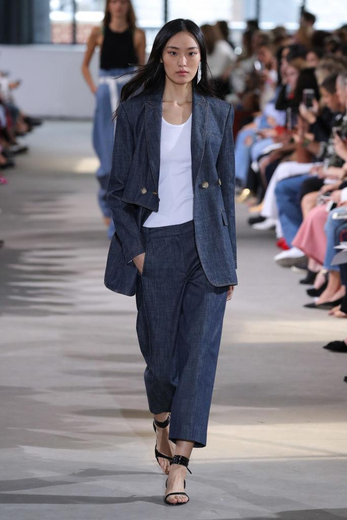 <p>Over at Tibi, models stepped out in chambray-effect two-piece suits. Take inspiration this season and seek asymmetric shapes and oversized fits. <em>[Photo: Getty]</em> </p>