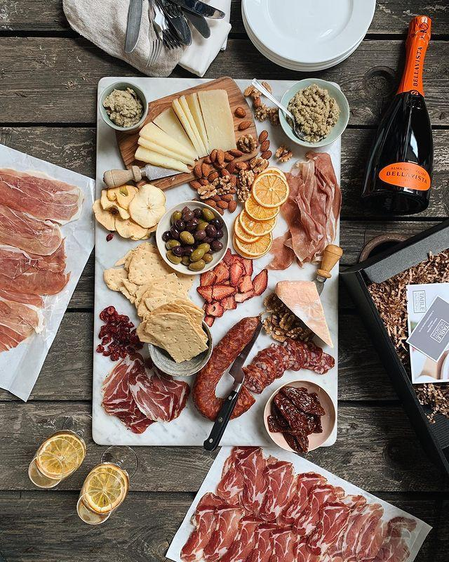 "<p>Italian food company Vallebona has risen to the occasion with its <a href=""https://www.vallebona.co.uk/cenetta-grazing-box/"" rel=""nofollow noopener"" target=""_blank"" data-ylk=""slk:selection of grazing boxes"" class=""link rapid-noclick-resp"">selection of grazing boxes</a>, perfect for al fresco dining be it in a garden or a picnic in the park. Vallebona supplies some of London's best restaurants, from Bocca di Lupo to The River Café, with meats, charcuterie and all sorts of mouthwatering Italian pantry goods, an indication of the exceptional quality of its products. The family-run business has lovingly curated the Cenetta Grazing Box, available in two sizes, filled with Sardinian pasta, Tuscan sausages, jarred artichokes, antipasti and a delicious selection of cheeses. The way that the food is packaged means it stays fresh for weeks - not that you'll be able to resist wolfing down the contents of the box in one short sitting. </p><p><strong>Delivery radius: </strong>Anywhere in mainland UK, including the Channel Islands, Highlands and Ireland for an extra delivery fee.</p><p><a href=""https://www.instagram.com/p/CBQrVHznR_7/?utm_source=ig_embed&utm_campaign=loading"" rel=""nofollow noopener"" target=""_blank"" data-ylk=""slk:See the original post on Instagram"" class=""link rapid-noclick-resp"">See the original post on Instagram</a></p>"