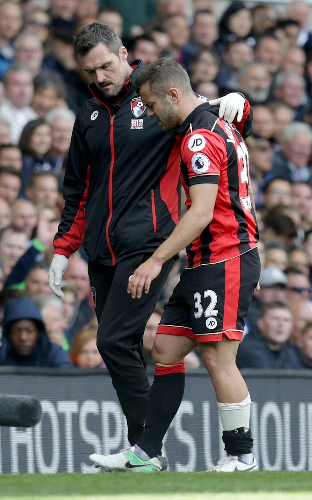 Jack Wilshere of AFC Bournemouth hobbles off the pitch injured Tottenham Hotspur v AFC Bournemouth - Credit: Rex