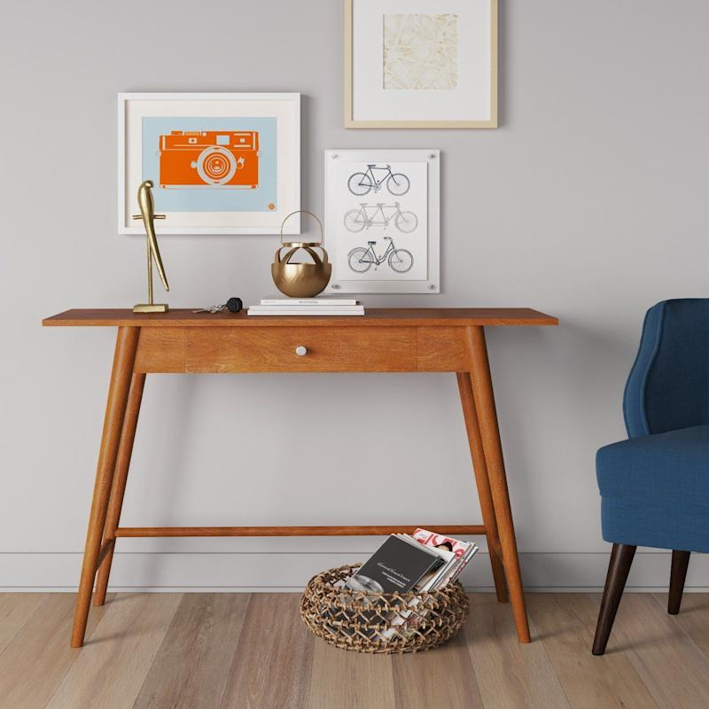 """<a href=""""https://www.target.com/p/amherst-mid-century-modern-desk-console-table-project-62-153/-/A-14963282#lnk=newtab"""" target=""""_blank"""">Shop it here</a>."""