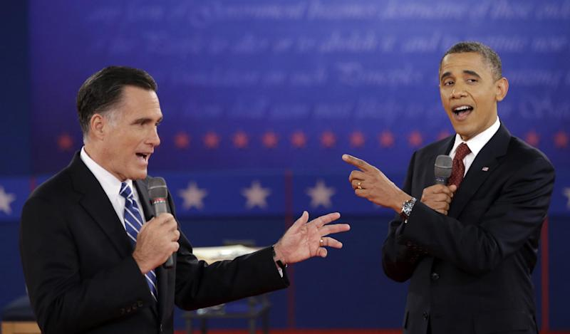 "FILE - In this Oct. 16, 2012 file photo, President Barack Obama and Republican presidential candidate, former Massachusetts Gov. Mitt Romney exchange views during the second presidential debate at Hofstra University in Hempstead, N.Y. They interrupt each other, bicker and ignore the moderator. Romney poses his own questions and demands answers. ""That's not true,"" Obama huffs over and over. This is presidential conduct? It was squirm-inducing for some viewers. But the candidates have little to lose by cranking up the heat in a tight face, where the focus is on persuading the undecided and firing up their fans. (AP Photo/David Goldman, File)"