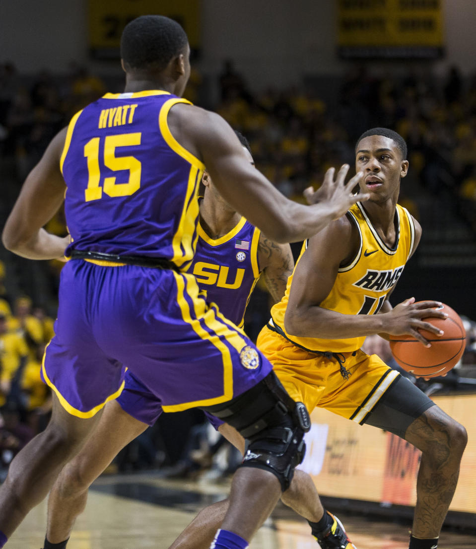 Virginia Commonwealth guard KeShawn Curry (11) looks to pass as LSU guard Andre Hyatt (15) plays defense during the first half of an NCAA college basketball game in Richmond, Va., Wednesday, Nov. 13, 2019. (AP Photo/Zach Gibson)