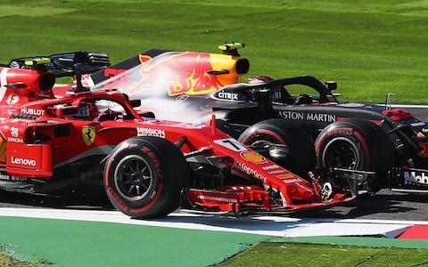 Kimi Raikkonen of Finland driving the (7) Scuderia Ferrari SF71H and Max Verstappen of the Netherlands driving the (33) Aston Martin Red Bull Racing RB14 TAG Heuer battle for position on track during the Formula One Grand Prix of Japan at Suzuka Circuit on October 7, 2018 in Suzuka - Credit: getty images