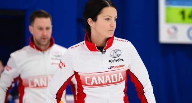 Brad Gushue, left, and Kerri Einarson fell 7-4 to Sweden in the bronze-medal match of the curling mixed doubles championship on Sunday. (@WorldCurling/Twitter - image credit)