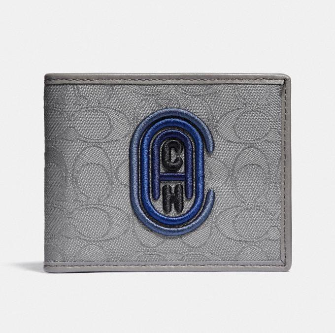 Double Billfold Wallet In Signature Jacquard With Coach Patch. Image via Coach.