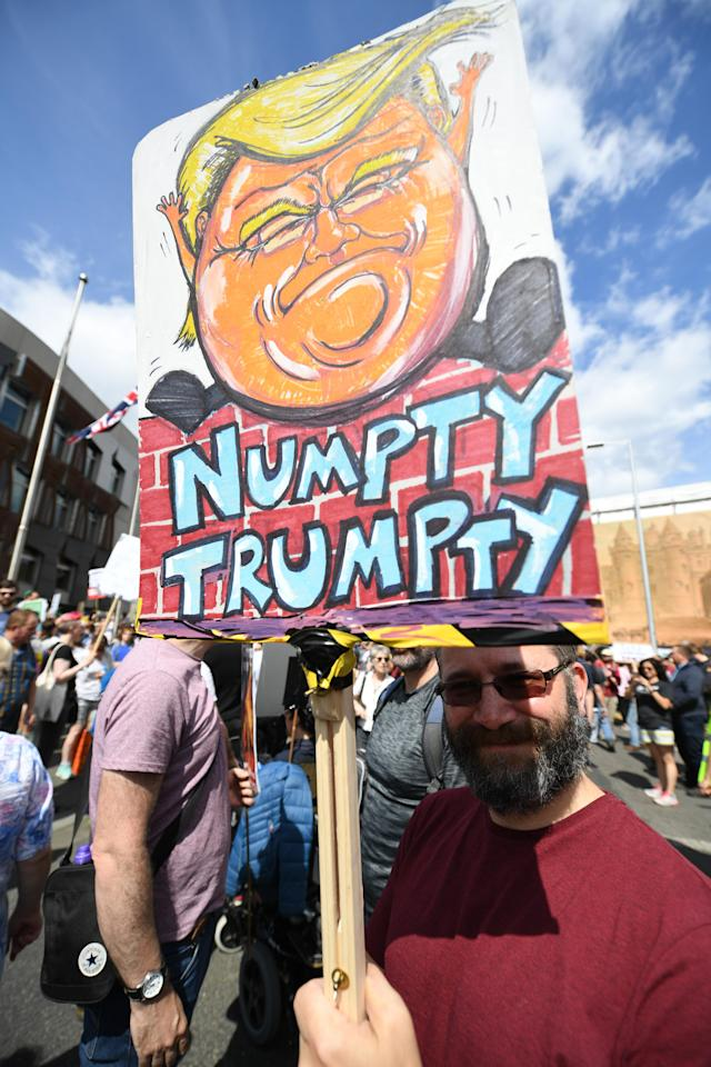 <p>A man holds an anti-Trump sign on July 14, 2018, in Edinburgh, Scotland, while the U.S. president is visiting Trump Turnberry Luxury Collection Resort in western Scotland. (Photo: Jeff J. Mitchell/Getty Images) </p>