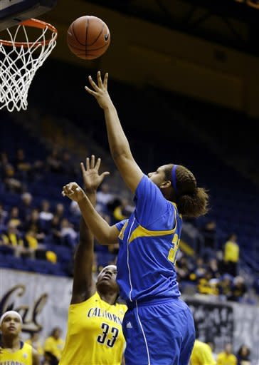 UCLA forward Alyssia Brewer, right, shoots against California center Talia Caldwell, left, during the first half of their NCAA college basketball game, Sunday, Jan. 20, 2013, in Berkeley, Calif. (AP Photo/Eric Risberg)