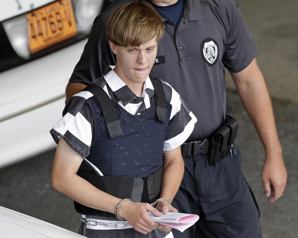In this June 18, 2015 file photo, Charleston, S.C., shooting suspect Dylann Roof is escorted from the Cleveland County Courthouse in Shelby, N.C. (Chuck Burton/AP)