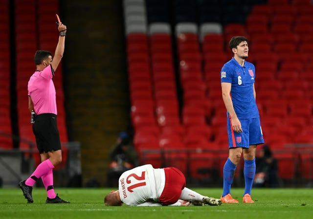 It was a forgettable night for Harry Maguire last time England played Denmark (Daniel Leal Olivas/PA)