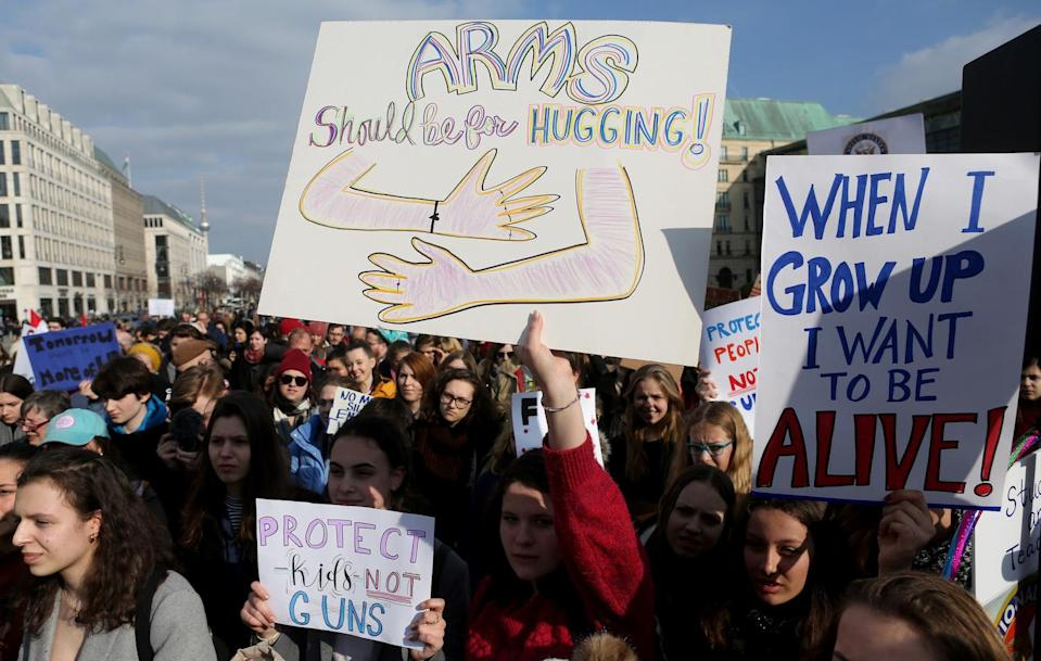 <p>Demonstrators protest at the March for our Lives demonstration in Berlin. (Photo: Adam Berry/Getty Images) </p>