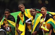 Yohan Blake, Usain Bolt, Nesta Carter and Michael Frater of Jamaica celebrate after winning gold (Getty Images)