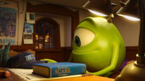 """This film publicity image released by Disney-Pixar shows the character Mike, voiced by Billy Crystal, in a scene from """"Monsters University."""" (AP Photo/Disney-Pixar)"""